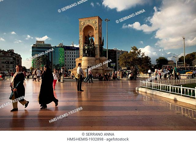 Turkey, Istanbul, Beyoglu, Taksim District, Taksim Square, pedestrians in front of the Republican monument of 1928 dedicated to Ataturk and to the Independance...