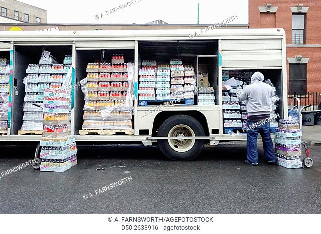 BRONX NY USA Street life Little Italy on Arthur Avenue. Drink delivery