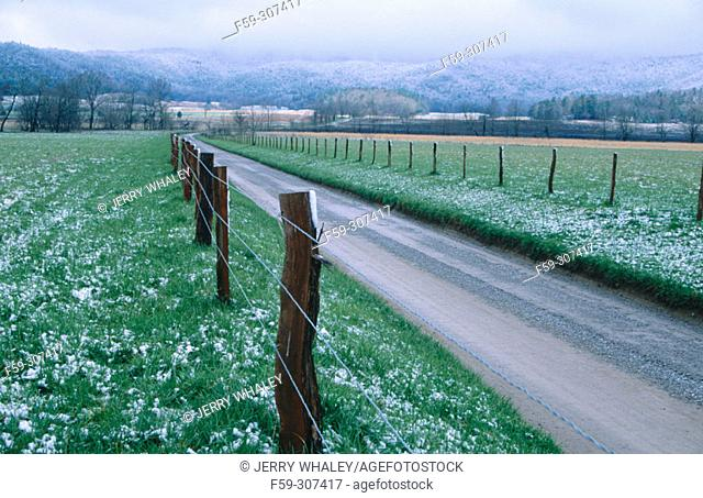 Spring snow and fence in Cades Coves. Great Smoky Mountains National Park. Tennessee, USA