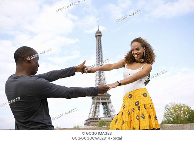 African couple dancing outdoors