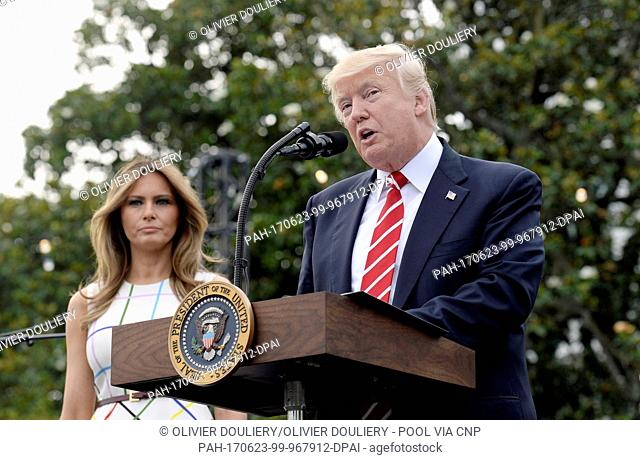 United States President Donald J. Trump speaks as First Lady Melania Trump looks on during the Congressional Picnic on the South Lawn of the White House in...