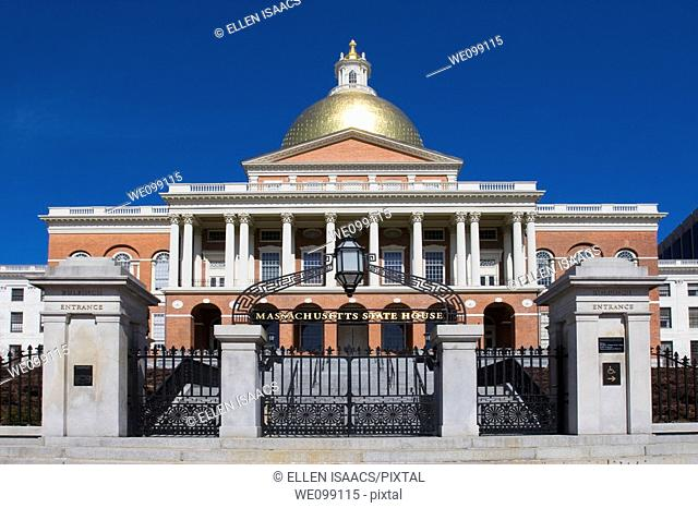 Front gate of the Massachusetts state house or capitol building in Boston, a brick building with gold dome
