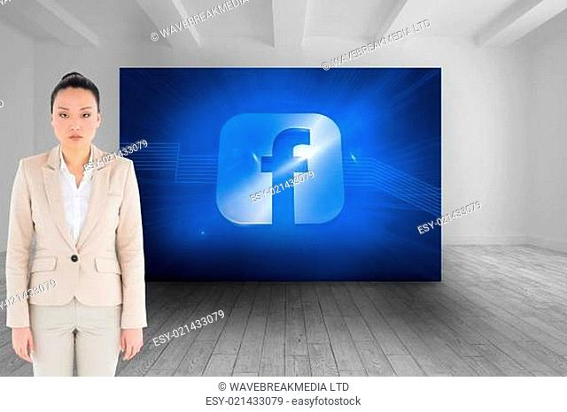 Composite image of unsmiling asian businesswoman