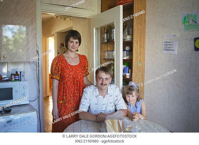 Siberian family at home in their apartment in Tobolsk, Tyumen Oblast, Siberia, Russia