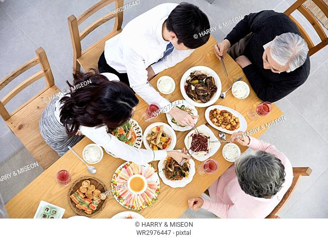 High angle view of harmonious family having meals