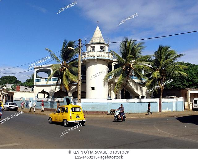 Yellow taxi in front of mosque, Antsiranana (former Diego-Suarez), capital of Diana Region, Madagascar, Indian Ocean