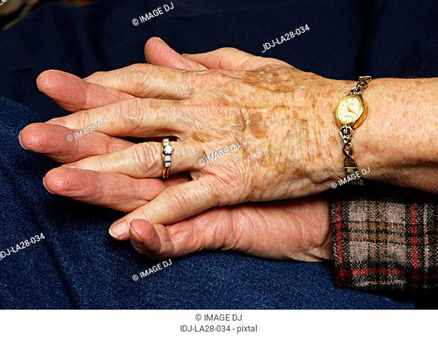 Close-up of a couples clasped hands