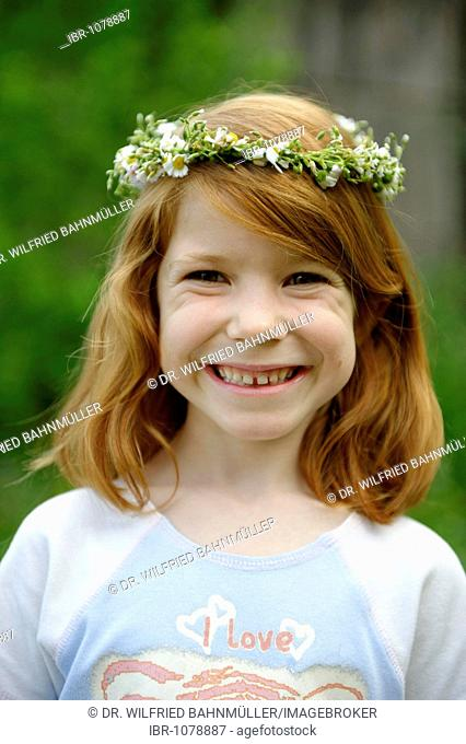 Young girl wearing a floral wreath in her hair