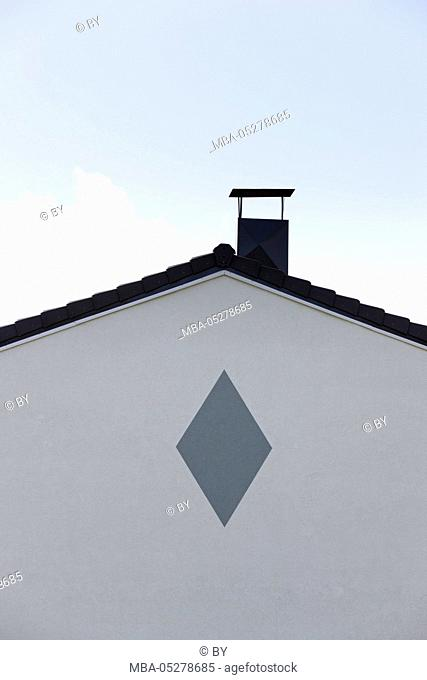Wall of a house with rhomb