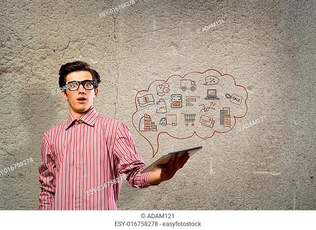 image of a young man with tablet computer, tablet fly with abstract symbols