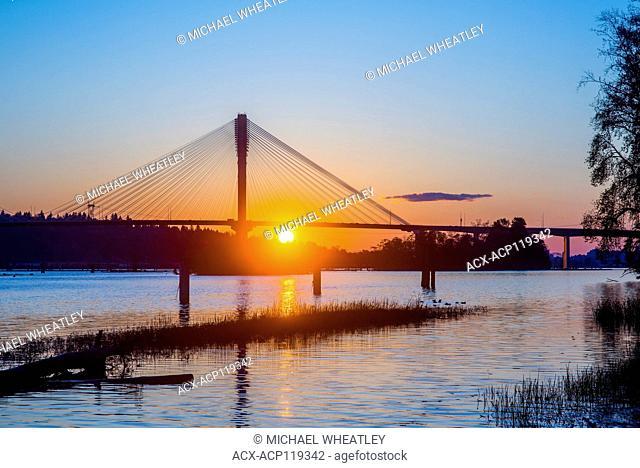 Port Mann Bridge over the Fraser River at sunset, Port Coquitlam, British Columbia, Canada