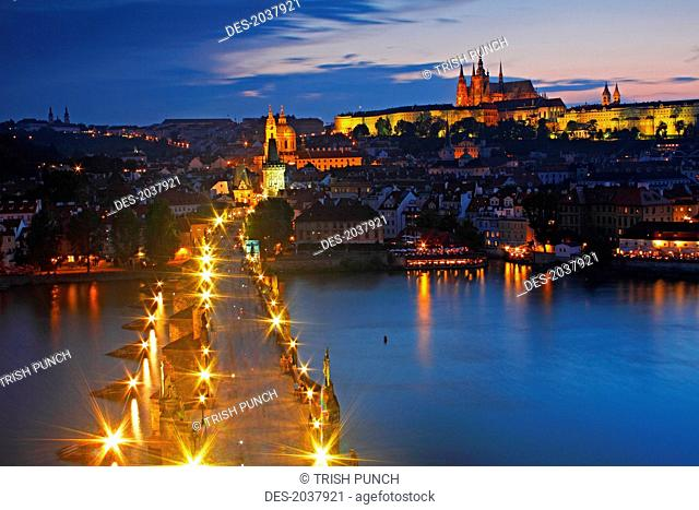 Night Lights Of Charles Bridge Or Karluv Most And Royal Palace On Castle Hill, Prague Czech Republic