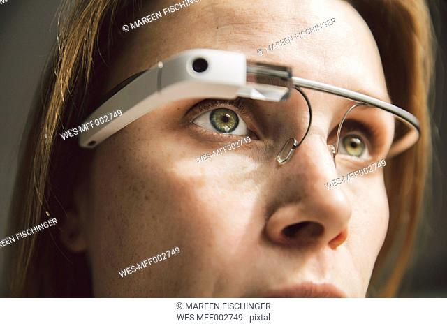Woman wearing optical head-mounted display