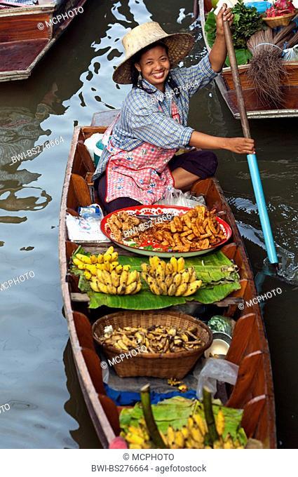 asian saleswoman with her boat at the Damnoen Saduak Floating Market, Thailand, Bangkok
