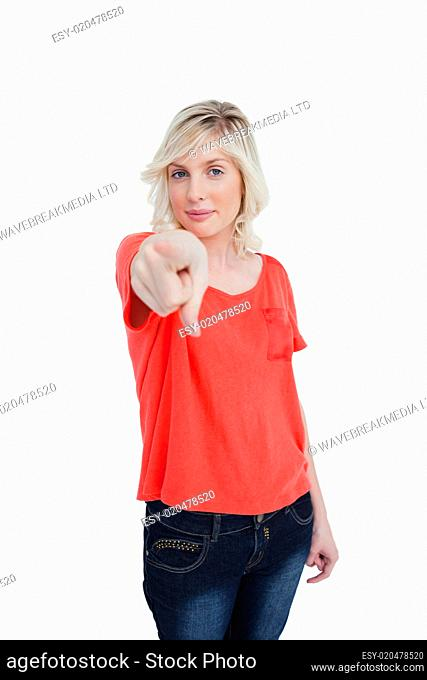 Young woman almost smiling while pointing her finger