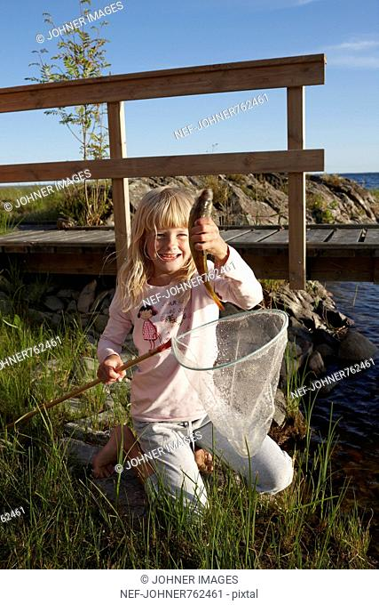 Girl with a newly caught fish, Sweden