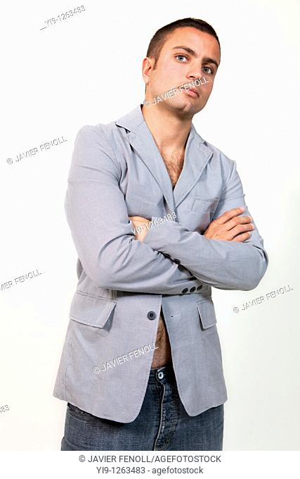 Young man wearing suit jacket and no shirt