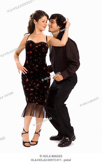 Studio portrait of couple dancing