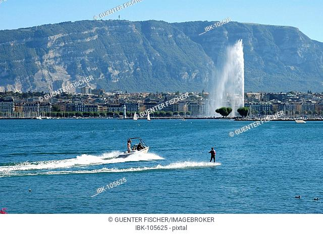 Water skiing at the lakefront La Rade giant fountain Jet d'Eau and mount Saleve Geneva Switzerland