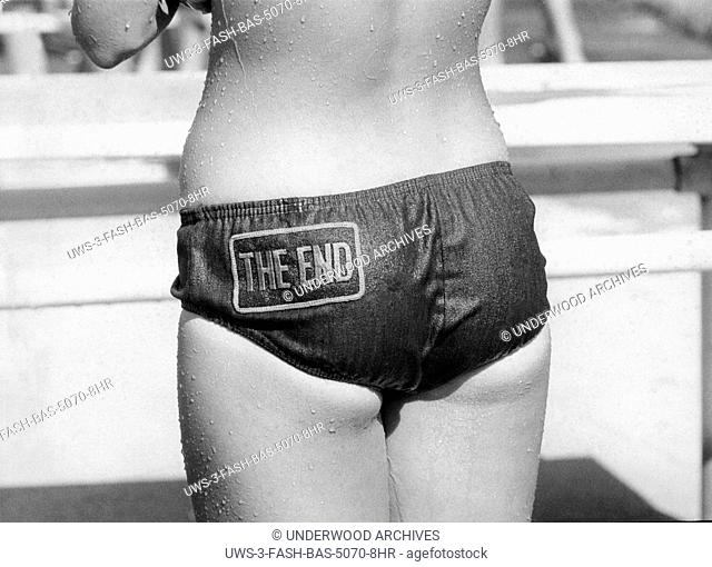 Metuchen, New Jersey: 1972.The best part of a bikini.. The End!