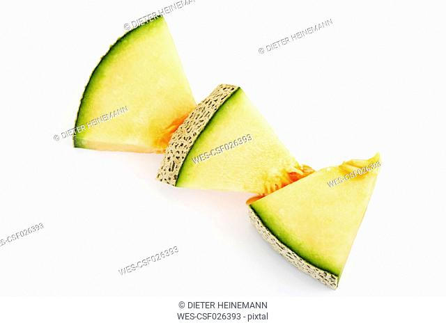 Three pieces of Galia Melon on white ground