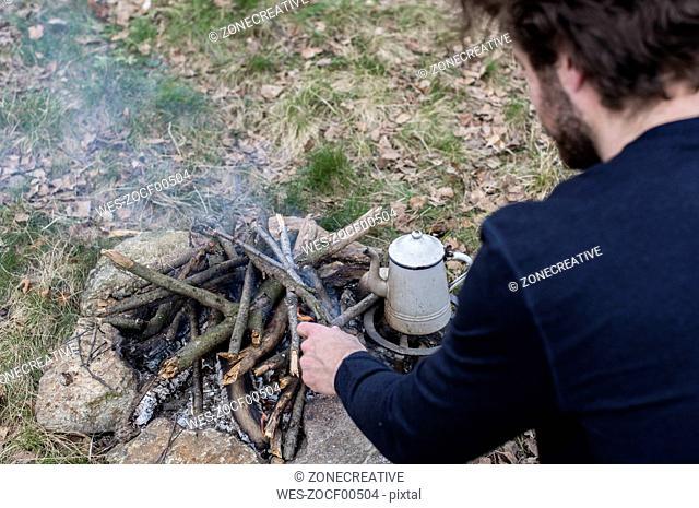 Man preparing campfire
