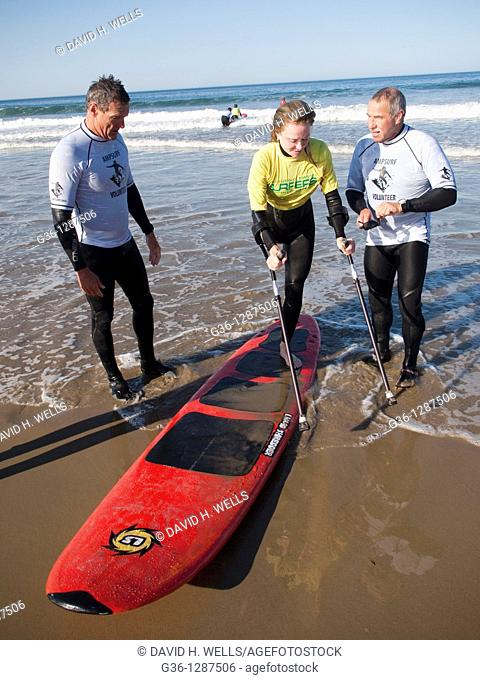 On the beach in Pismo Beach, California, during the Surf Clinic sponsored by AmpSurf, Julie Jo Caruthers, who lost one leg to Chondrosarcoma