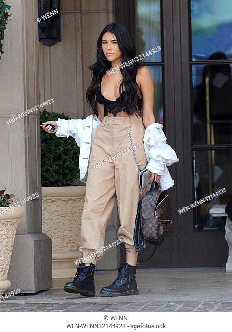 Madison Beer leaving the Montage Hotel in Beverly Hills after visiting Justin Bieber. The singer was all smiles for the cameras wearing a sexy low cut top...