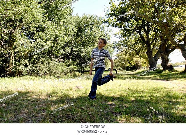 Boy running in a park