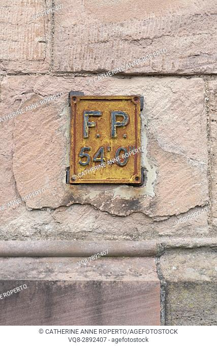 corroded Victorian fire hydrant sign on red sandstone barracks wall in Monmouth, Wales, Uk