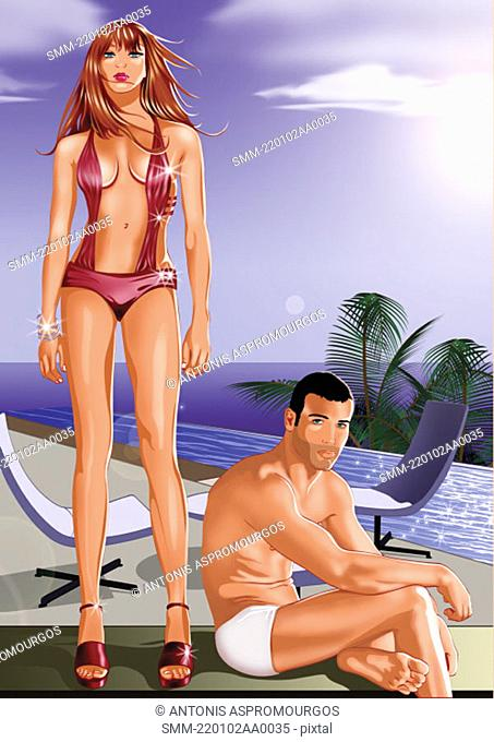 Young couple on beach in swim suits