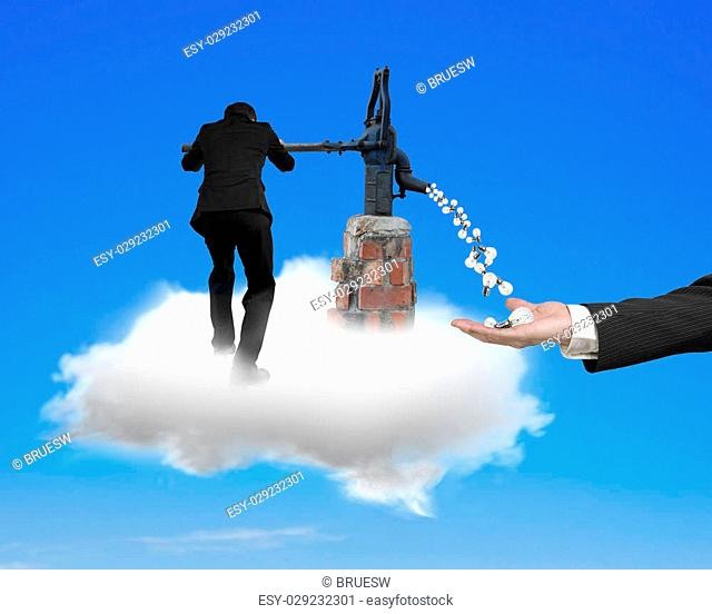 Businessman using water pump drawing out light bulbs hand holding , standing on white cloud