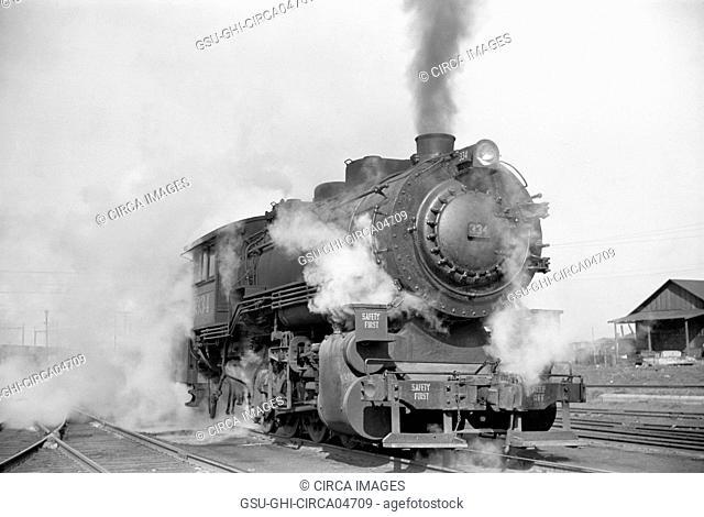 Locomotive in Railway Yard along River, St. Louis, Missouri, USA, Arthur Rothstein for Farm Security Administration, January 1939