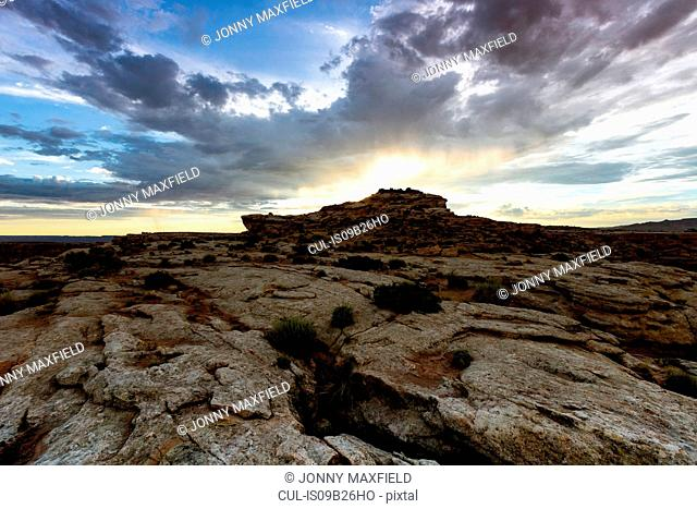 View of sunburst over rock formation, Alstrom Point, Utah, USA