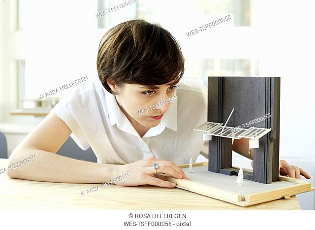 Woman with architectural model