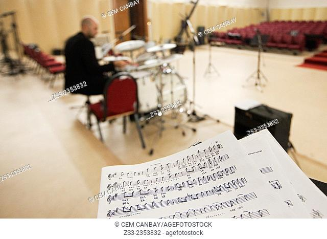 Drummer at the rehearsal with the musical notes in the foreground, Istanbul, Turkey, Europe