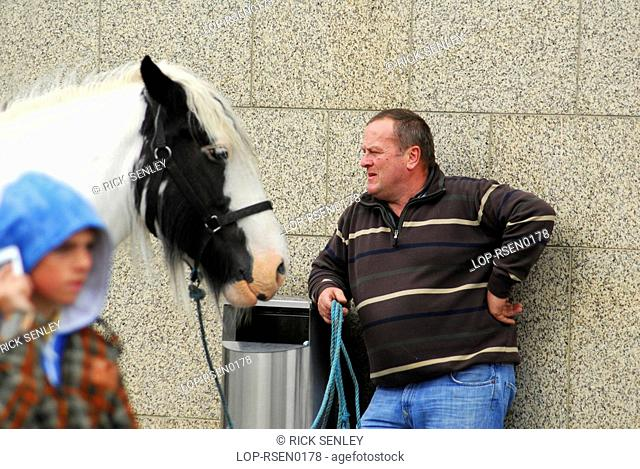 Republic of Ireland, Dublin, Smithfield Horse Market, A buyer with a horse at Smithfield Horse Market in Dublin