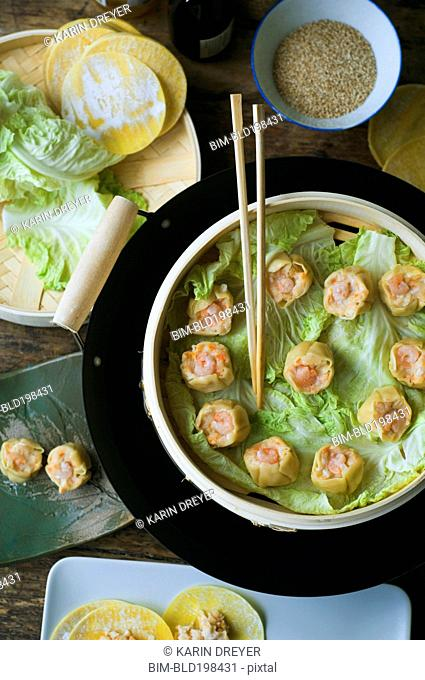 Asian dumpling in steamer with cabbage