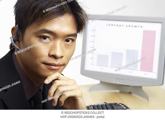 Portrait of a businessman thinking in front of a progress report