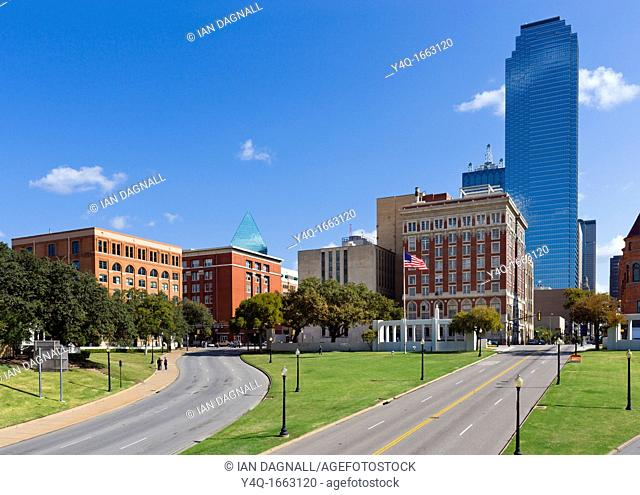 Site of the Kennedy assassination looking towards Dealey Plaza with old Texas Schoolbook Depository to the left, Dallas, Texas, USA