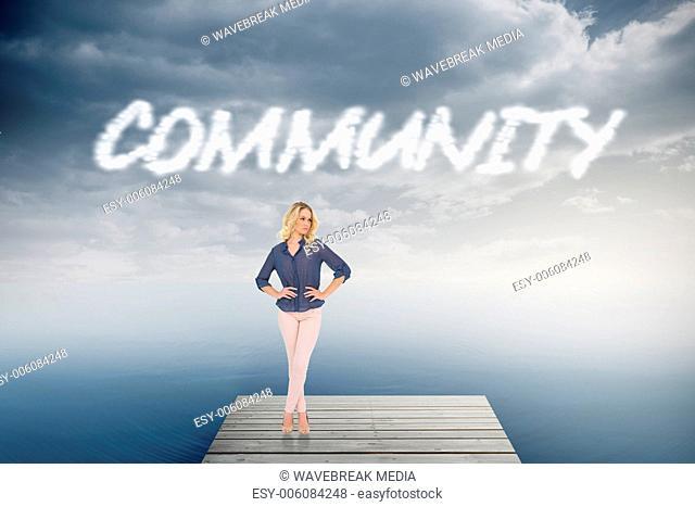 Community against cloudy sky over ocean
