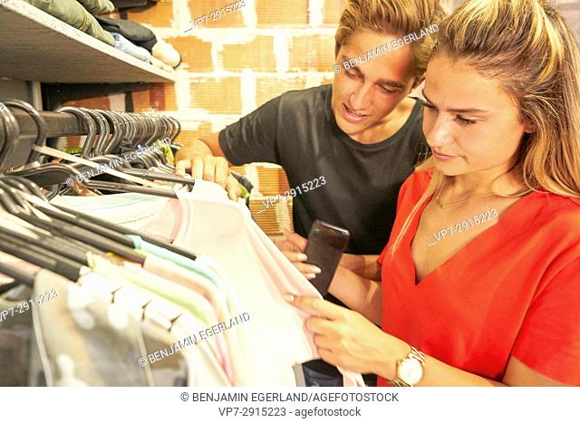 Young Dutch couple shopping together clothes in clothing store