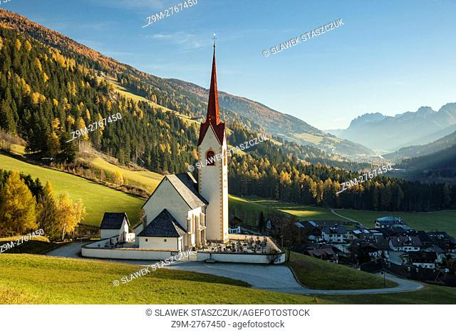 Autumn morning at the iconic alpine church in Winnebach, South Tyrol, Italy