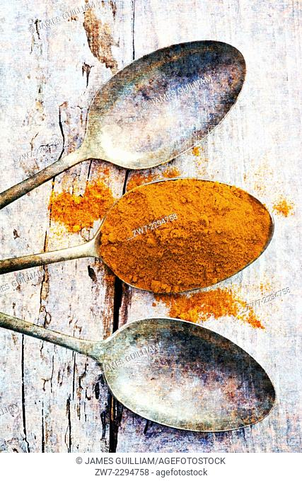 Turmeric with antique spoons