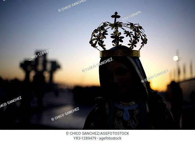 A statue of Our Lady of Guadalupe is silhouetted against the sunrise in Mexico City, December 10, 2010  Hundreds of thousands of Mexican pilgrims converged on...