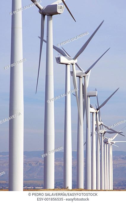 windfarm fied with cloudy sky in Pozuelo de Aragon, Saragossa, Aragon, Spain
