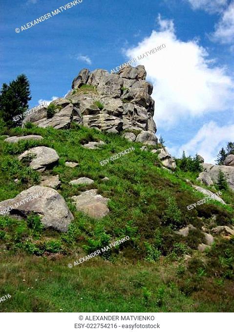 big rock like frog and blue sky