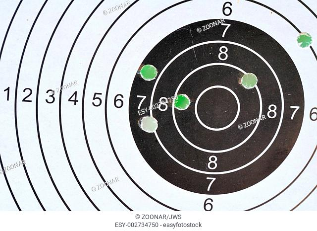Bullet holes in shooting target Stock Photos and Images