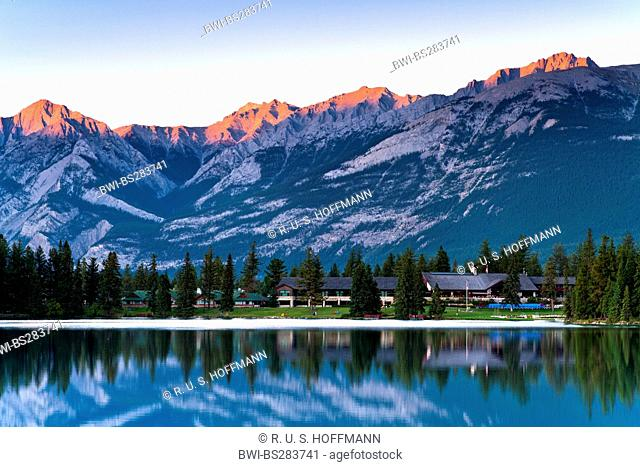 tops of the Rocky Mountains glowing red in the light of the setting sun, Canada, Alberta, Jasper National Park