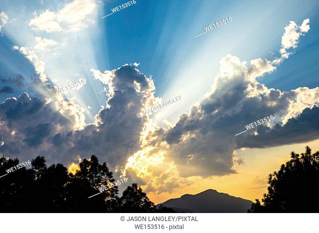 Dramatic sunbeams and clouds in blue sky, Thừa Thiên-Huế Province, Vietnam